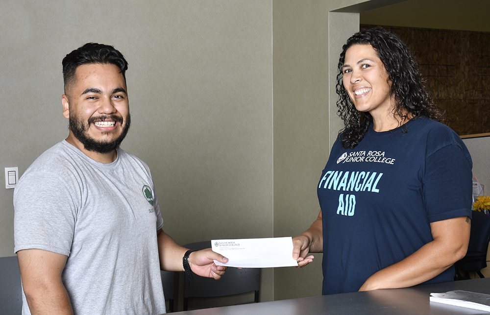 Staff awarding financial aid to student