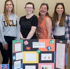 Students and their poster at the Petaluma Student Research Conference